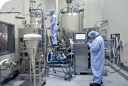 A technology transfer engineer working inside a pharmaceutical process development facility